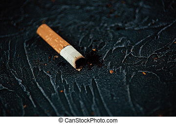Smoldering cigarette. Harmful habit.