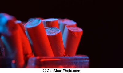 Smoldering cigarette in an ashtray