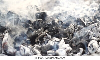 smoldering embers and smoked ashes on the bonfire, natural ...