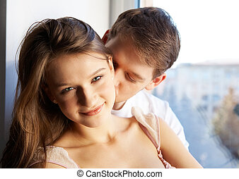 Smooch  - Close-up of young man kissing in woman?s neck