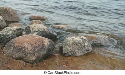 smooth boulders polished by waves - huge smooth boulders...