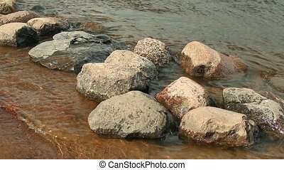 smooth boulders washed by waves