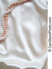 Smooth elegant white silk with pearls as background