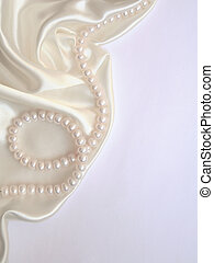 Smooth elegant white silk with pearls as wedding background
