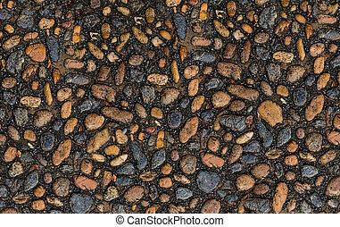 smooth fine cobblestone surface in a dark base with fine dark sand weather-beaten foundation design