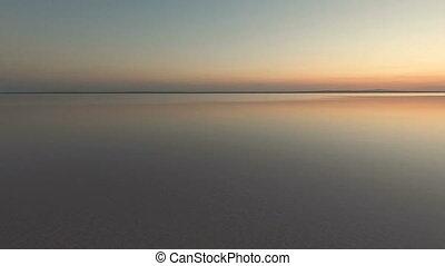 Smooth lake water at sunset. Tuz Salt Lake, Anatolia, Turkey