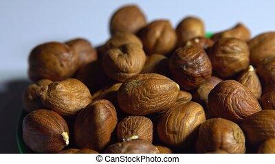 Smooth rotation of hazelnut kernels close-up.