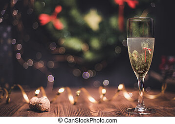 Smooth shady christmas and new year decoration background with round bokeh, golden ribbon and champagne and cork