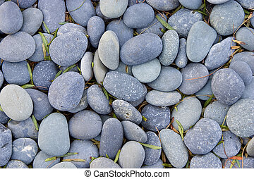 Smooth Stones - Looking down on smooth riverbed stones.
