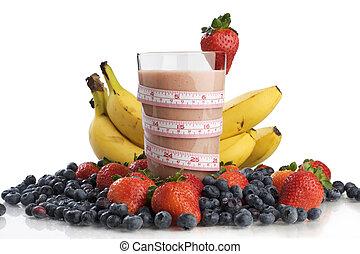 Smoothie surrounded by fruit and wrapped with a tape measure