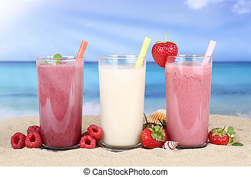 Smoothie fruit juice with fruits on the beach