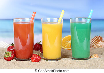 Smoothie fruit orange juice with fruits on the beach
