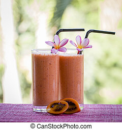 Smoothie of tamarillo, banana and papaya, close up