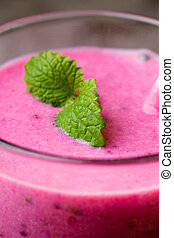Smoothie, pink juice on the grey background.