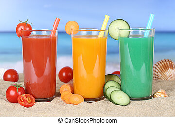 Smoothie vegetable tomato juice with vegetables on the beach