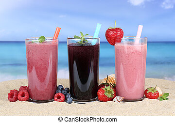 Smoothies fruit juice with fruits smoothie on the beach