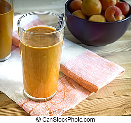 Smoothies of ripe apricots with yogurt in glasses.