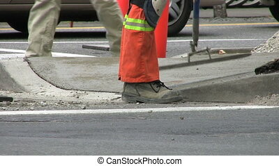Smoothing Wet Cement - A Construction Worker Smoothing Wet...
