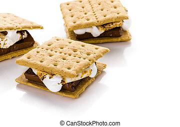 Freshly toasted smores with large white marshmallows.