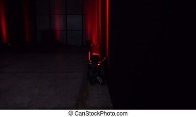 Smouldered red spot light in a dark room