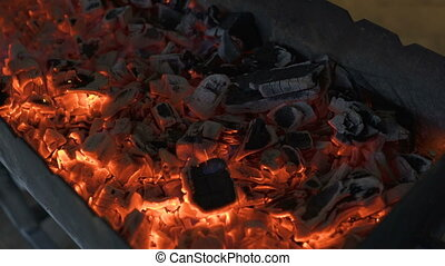 smouldering coals charcoal in the grill. - smouldering coals...
