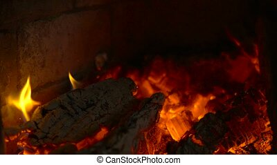 Smouldering coals in a fireplace. Slow motion - Burn-out...