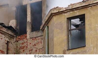 Smouldering structural fire on abandoned building -...