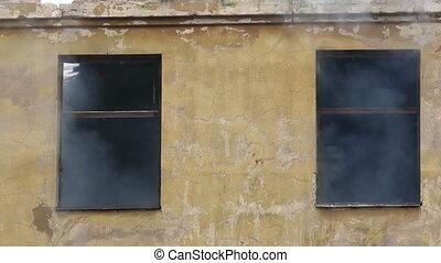 Smouldering structural fire on burning abandoned building