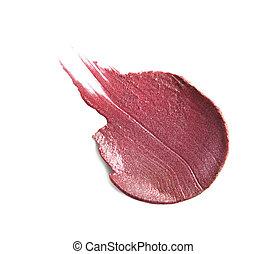 Smudged lipstick on white background