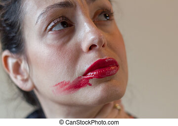 Smudged red lipstick