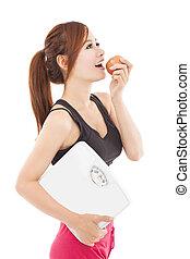 smuk kvinde, ædt æble, sunde, unge
