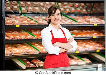 smukke, saleswoman, beliggende, arme krydsede, ind, slagter...