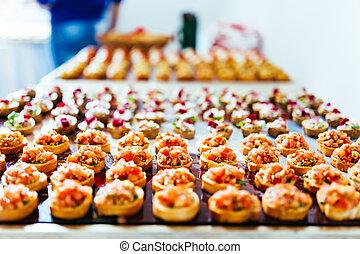 Snack buffet - Small bruschetta arranged for a snack buffet.