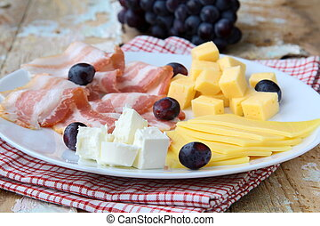Snack cheese plate with grapes