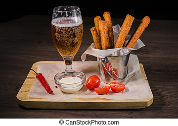 Snack for beer in the form of crackers and sauce for them