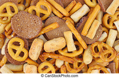 Close view of a snack mix with pretzels and bread croutons.