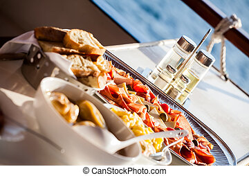 snack platter - an angled image of a snack platter with ham,...