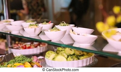 Snack table with salads and vegetables