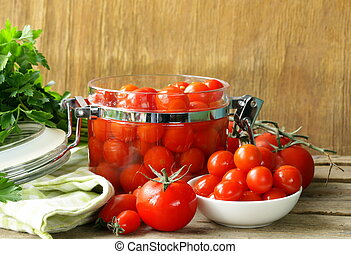 snack tomatoes pickled with herbs and spices