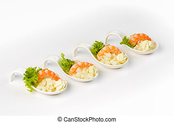 Snack with shrimp and apple in a glass boat on a white background