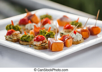 Snacks - A plate filled with different snacks.