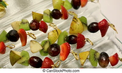 snacks with fruit on skewers lying