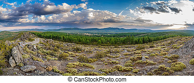 Snake mountain and cloudy sky at dusk in Spain - Panoramic...