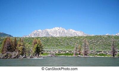Snake River and Grand Teton Mountain Peaks, Wyoming, USA. Slow Motion