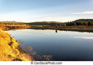 Snake River landscape taken during the golden hour in Grand Teton National Park