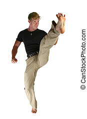 Casual male doing front snap kick, full body, over white.
