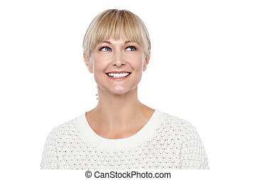 Snap shot of a smiling blonde looking upwards
