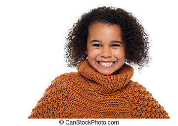Snap shot of a stylish african girl in winter clothes