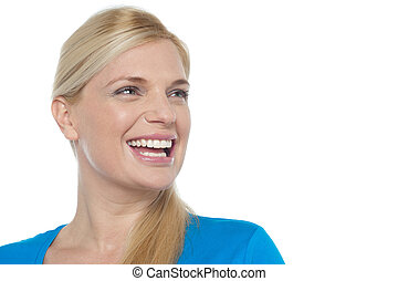 Snap shot of a woman laughing while looking away