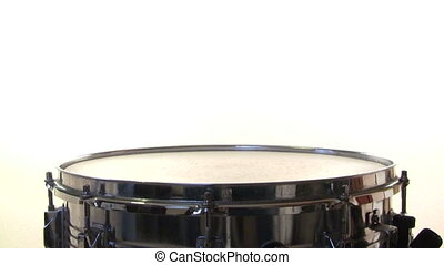 Snare Drum Roll on white background - A snare drummer does a...